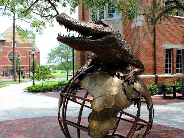 Gator on a globe statue UF campus