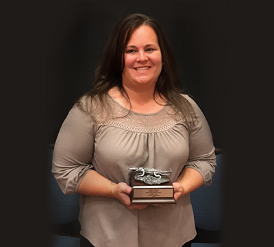 Jessica Lee holding Employee Recognition Award