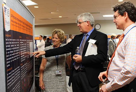 Dr. Tim Morey viewing a poster