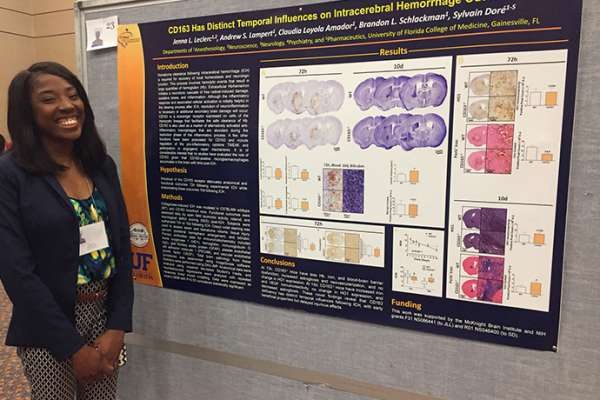 Dore Lab member presenting a research poster