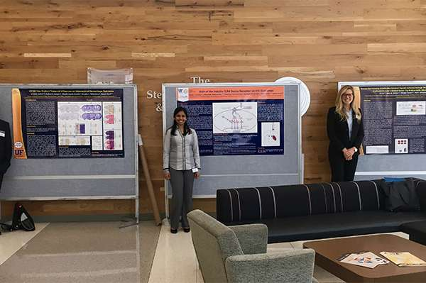 Dore Lab members with their research posters