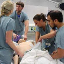Critical care medicine fellow training on a simulator