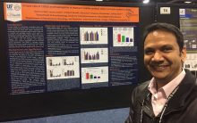 Dr. Ahmed with a poster presentation