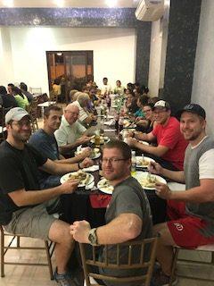 Team eating a meal in Ecuador