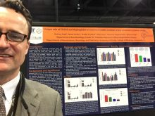 Dr. Dore with a poster presentation