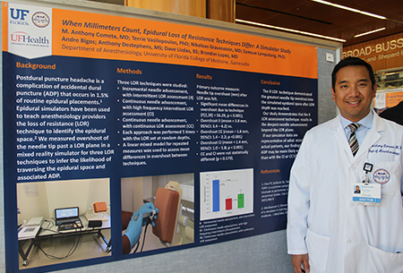 Anthony Cometa, MD, and poster