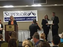 Kathy Parrish receiving the superior accomplishment award