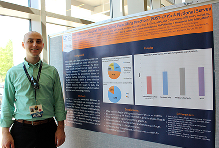 Kevin Olsen, MD, and poster