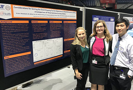 UF medical students present their poster at the COM celebration of research