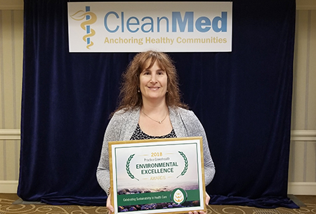 Lauren Berkow, MD, accepting the environmental excellence award