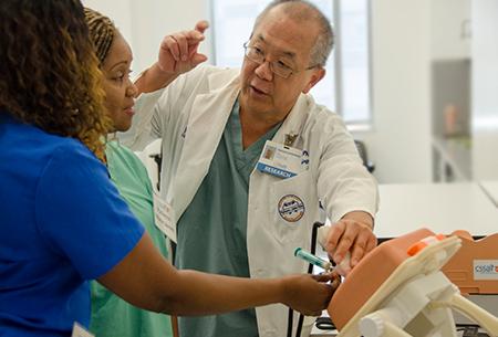 Dr. Lampotang demonstrating a simulator