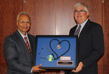 Dr. Shah being presented an award by Dr. Morey