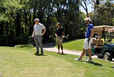 Drs. Kiley and Antony playing golf with Tony DeStephens