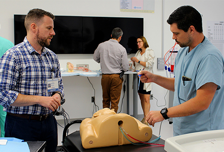 Fellows working in the sim lab
