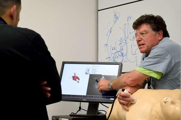 Dr. McGough teaching a resident