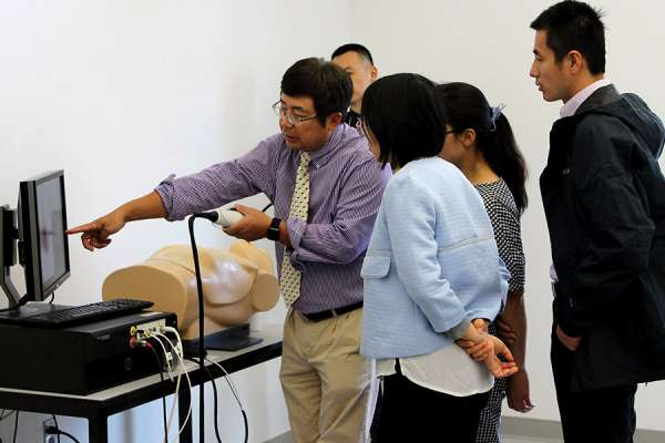 Dr. Peng training visiting scholars on a sim