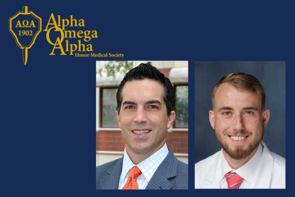Doctors Giordano and Bannister with the Alpha Omega Alpha logo