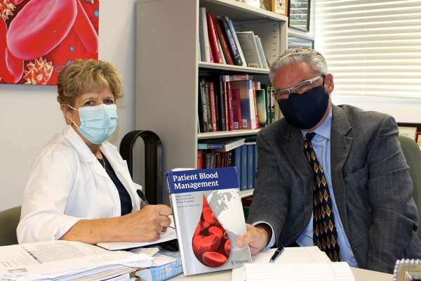 Mary Jane Michael and Dr. Bruce Spiess working on patient blood management