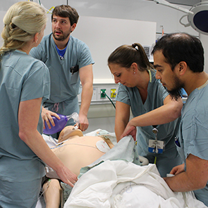 Critical care medicine fellow training on a simulator