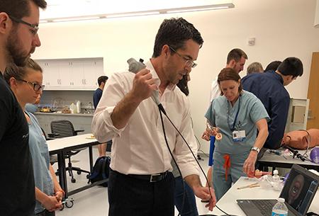 Drs. Giordano and White demonstrating simulators