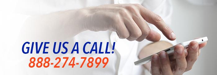 man's hands dialing a phone