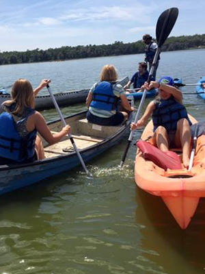 Students socializing in kayaks