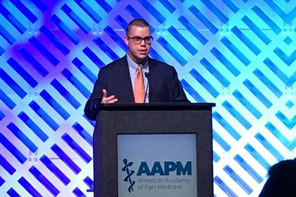 Dr. Tighe moderating a session at the AAPM conference