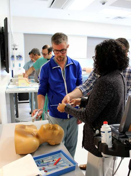 CCM fellows working in the simulation lab