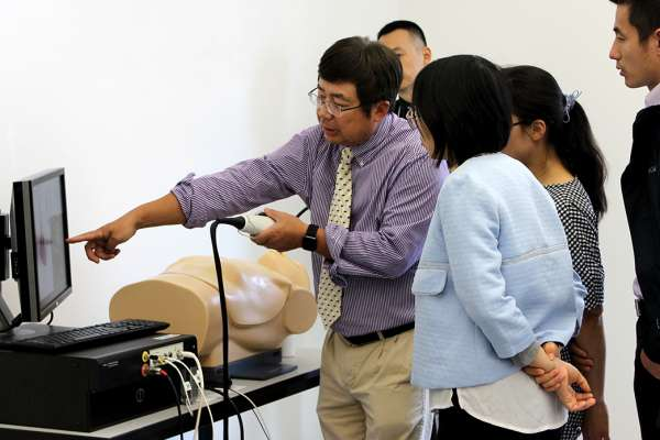Dr. Peng instructing with a simulator