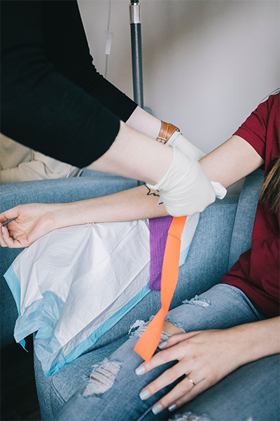 a women's arm being readied to donate blood