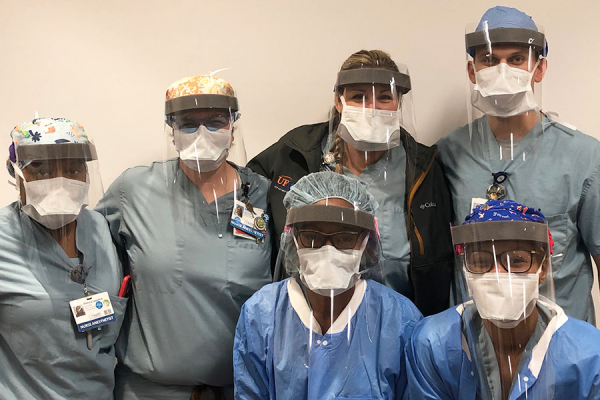 Anesthetists wearing face shields