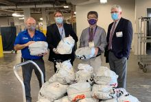 Doctors Morey and Peng receiving personal protective equipment shipment