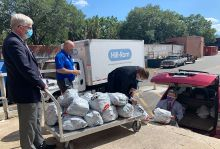 Loading a vehicle with bags of personal protective equipment