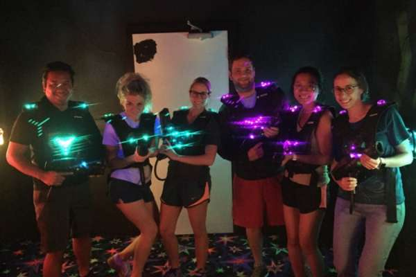 Residents playing laser tag