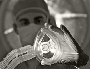 Anesthesiologist placing a mask on patient