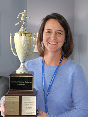 Jenny Barghout holding the walking challenge trophy