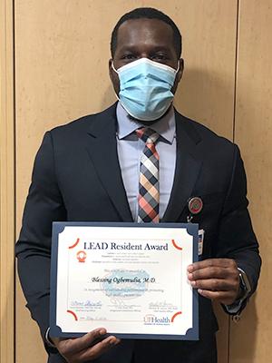 Doctor Ogbemundia receiving LEAD award