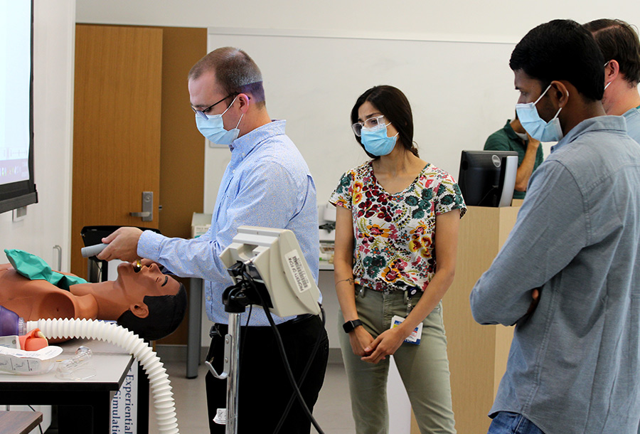 Doctor Cates demonstrating intubation