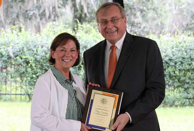 Kelly Spaulding receiving service award