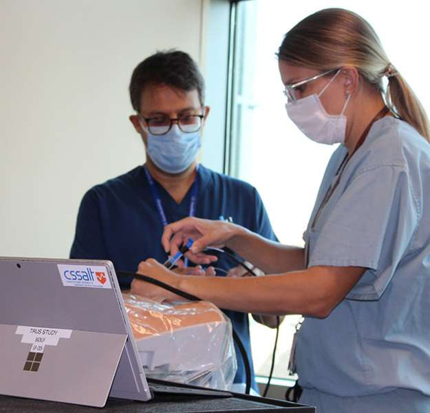 Surgery resident practicing on the R-E-B-O-A simulator