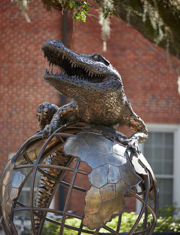 Gator on top of the world statue